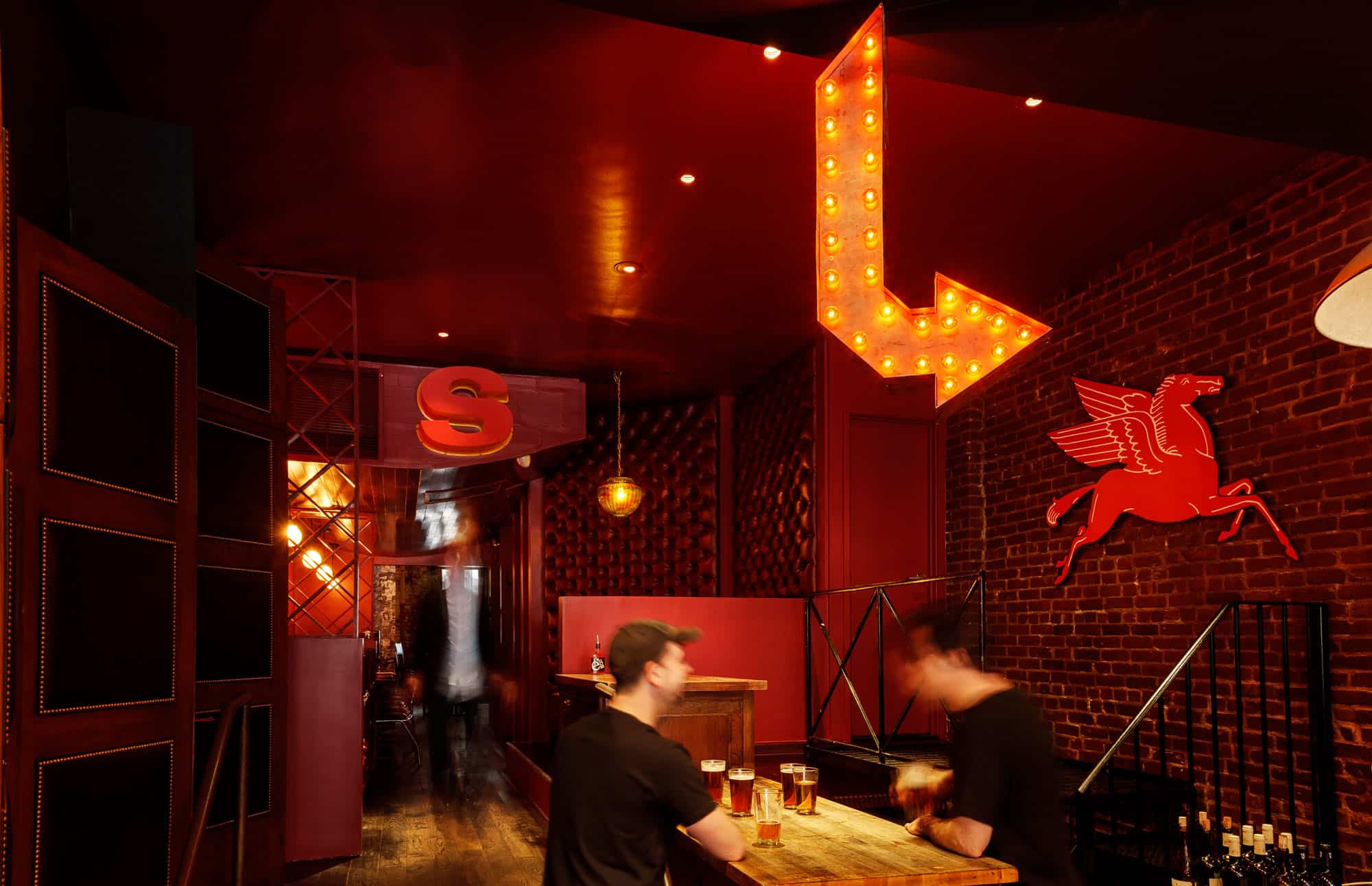 Interior photo of e's BAR with lighted sign